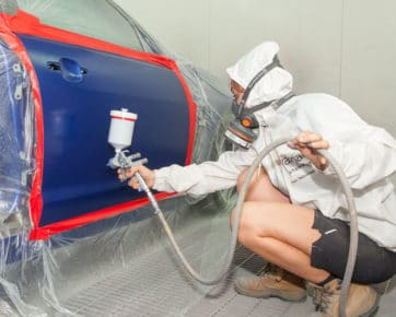 Car painter spray painting car door - car painting Albion, Brisbane